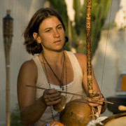 Claudia Lyra with berimbau